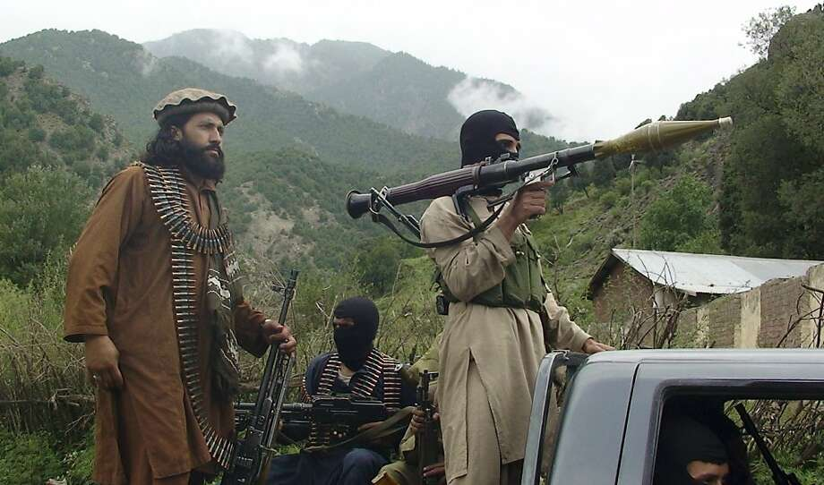 Pakistan Taliban patrol in South Waziristan in August. The fractured militant groups are losing the backing of tribesmen weary of the long war. Photo: Ishtiaq Mahsud, Associated Press