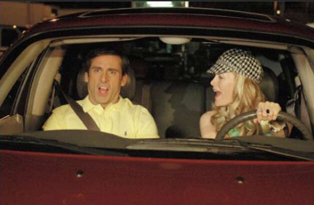 Leslie Mann (R) in ''The 40-Year-Old Virgin'' with Steve Carrell (L).
