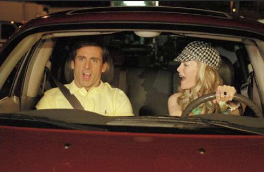 Leslie Mann(R) in ''The 40-Year-Old Virgin'' with Steve Carrell (L).