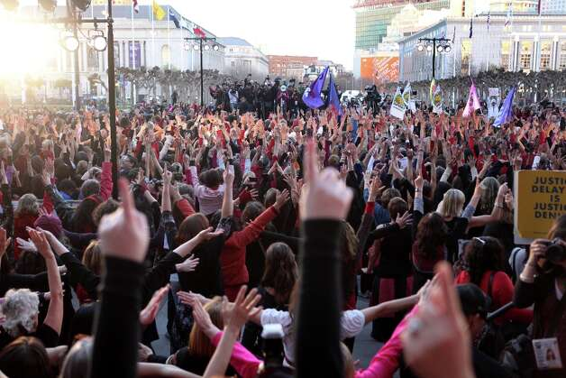 Brianna Sanders holds her hands up during the finale of a One Billion Rising event at City Hall on February 14, 2013 in San Francisco, Calif. Photo: Pete Kiehart, The Chronicle / ONLINE_YES