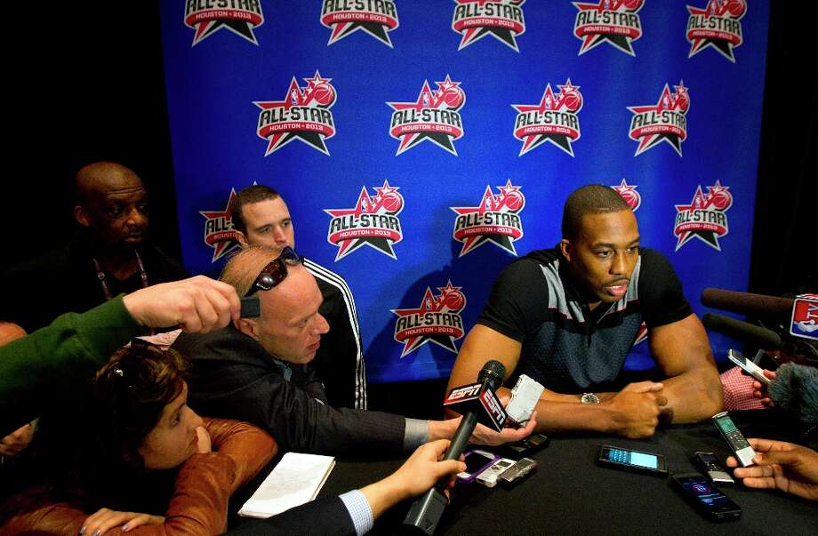 Dwight Howard is interviewed during a media day. Photo: Cody Duty / © 2013 Houston Chronicle