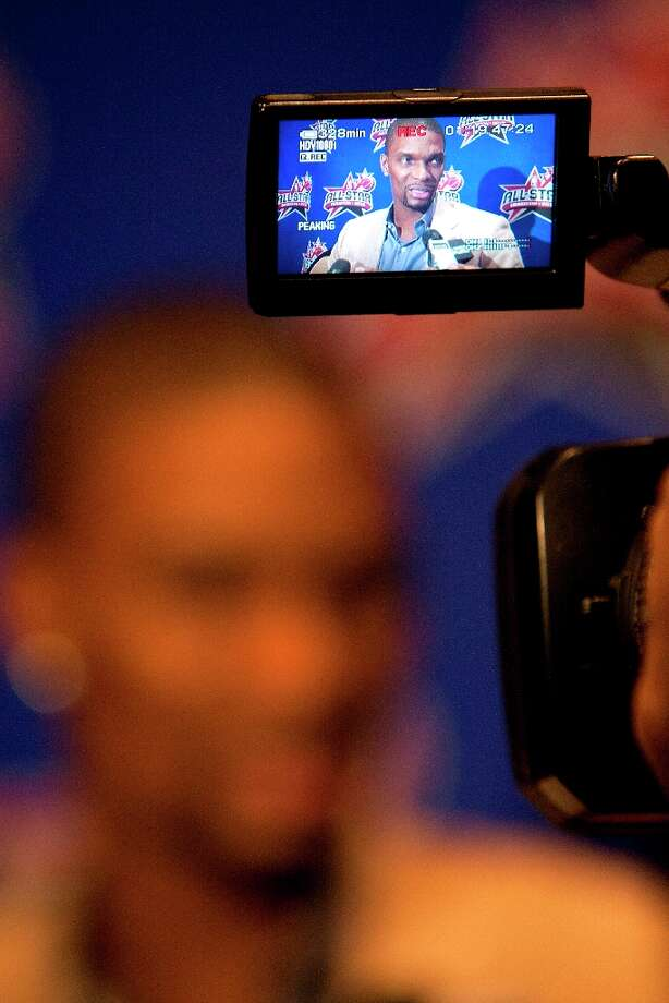 Miami Heat's Chris Bosh is interviewed during a media availability at the Hilton Americas Friday, Feb. 15, 2013, in Houston. Photo: Cody Duty / © 2013 Houston Chronicle