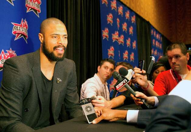 Tyson Chandler, New York Knicks, left, is interviewed during a media availability at the Hilton Americas Friday, Feb. 15, 2013, in Houston. Photo: Cody Duty / © 2013 Houston Chronicle