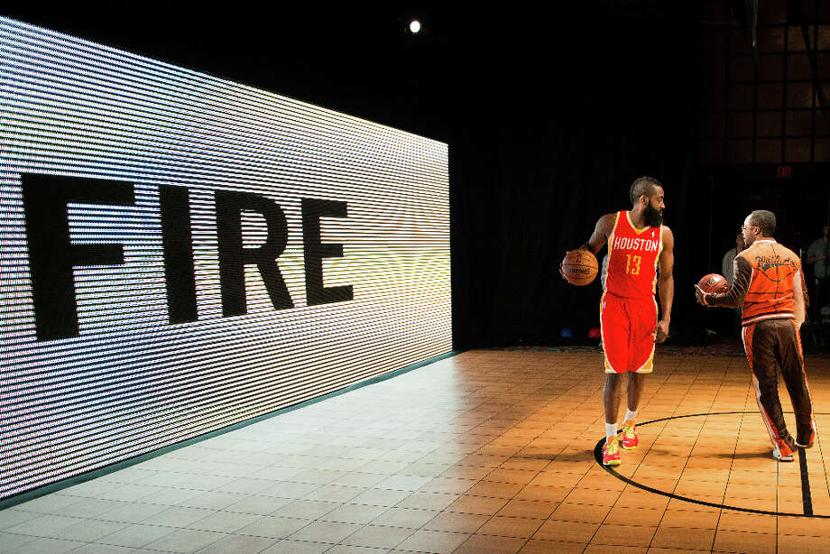 Houston Rockets shooting guard James Harden dribbles a basketball during the shooting of a promotional video with recording artist will.i.am during a whirlwind round of appearances for the NBA All-Star Game at the Hilton Americas hotel on Friday, Feb. 15, 2013, in Houston. Photo: Smiley N. Pool, Houston Chronicle / © 2013  Houston Chronicle