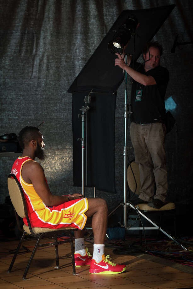 A technician focuses a spotlight on Houston Rockets shooting guard James Harden during the shooting of a promotional video with recording artist will.i.am during a whirlwind round of appearances for the NBA All-Star Game at the Hilton Americas hotel on Friday, Feb. 15, 2013, in Houston. Photo: Smiley N. Pool, Houston Chronicle / © 2013  Houston Chronicle