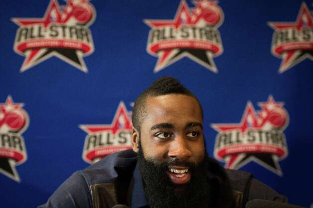 Rockets shooting guard James Harden smiles as he addresses the media during a round of interviews. Photo: Smiley N. Pool / © 2013  Houston Chronicle
