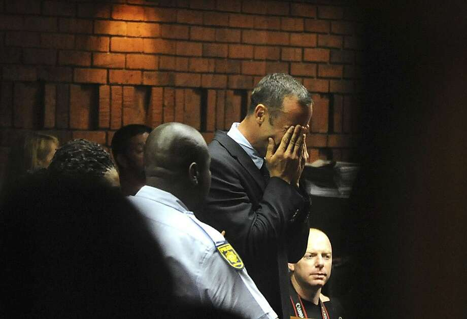 Oscar Pistorius sobs in court, where he learned he would be tried for murder. Photo: Antoine De Ras, Associated Press