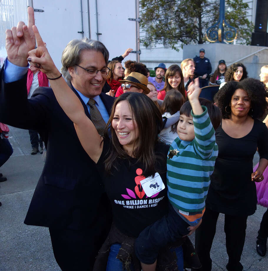 Ross Mirkarimi, along with his son, Theo and wife, Eliana Lopez, participate in the One Billion Rising event at City Hall Thursday.