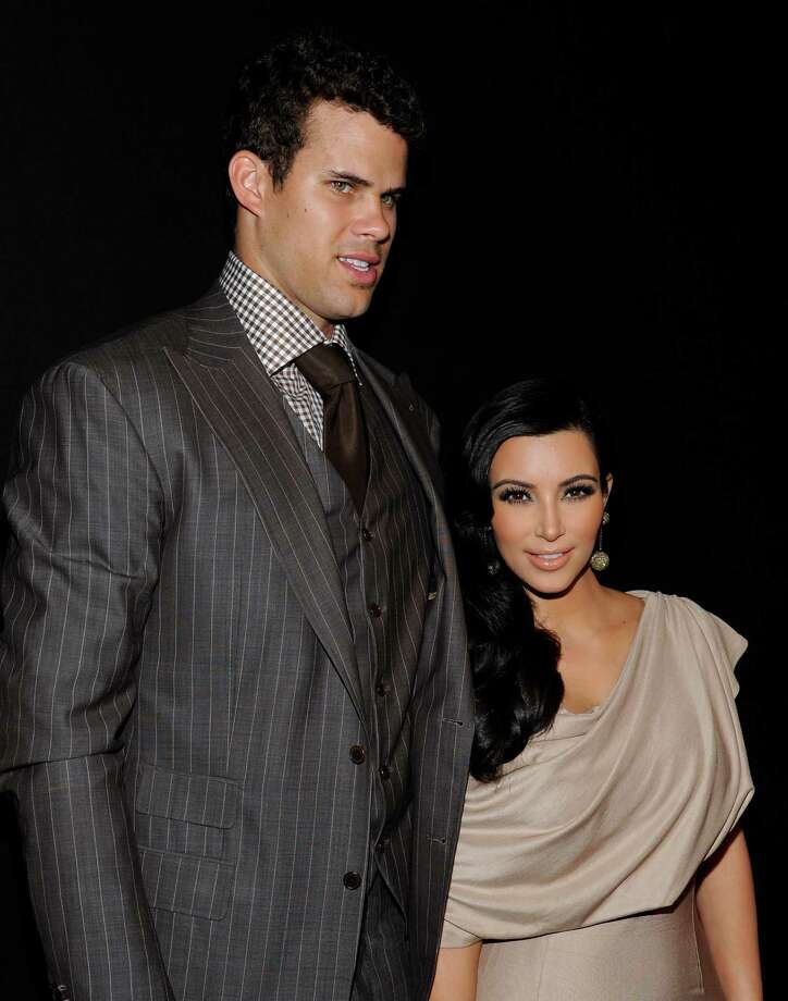 FILE - In this Aug. 31, 2011 file photo, newlyweds Kim Kardashian and Kris Humphries attend a party thrown in their honor at Capitale in New York. Attorneys for Kardashian and Humphries are due in a Los Angeles courtroom on Friday, Feb. 15, 2013 to argue over a trial date to end the couple's 72-day marriage. Humphries is seeking to delay the case until after the NBA season is over, while Kardashian wants the marriage ended as soon as possible. (AP Photo/Evan Agostini, File) Photo: Evan Agostini