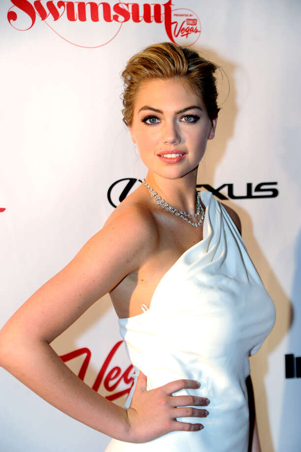 In this photo provided by the Las Vegas News Bureau, 2013 Sports Illustrated Swimsuit Issue cover model Kate Upton walks the red carpet at 1 OAK Nightclub at The Mirage, Thursday, Feb. 14, 2013, in Las Vegas. The models currently featured in the issue are in Las Vegas for three days of events in conjunction with the unveiling of the annual issue on Valentine's Day. (AP Photo/Las Vegas News Bureau, Brian Jones) Photo: Brian Jones