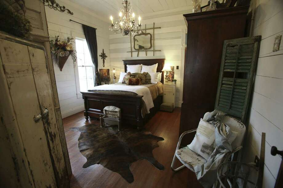 Exposed wood walls and oak floors drew Jayme and Shane Boscamp to their one-bedroom cottage in New Braunfels. Photo: Photos By Helen L. Montoya / San Antonio Express-News