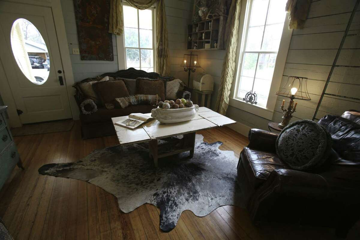 The original front door with its beveled glass intact was found in the garage and restored to the living room. The Boscamps said they were able to fit everything they need into their 811-square-foot home.