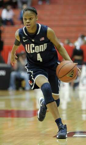 Connecticut guard Moriah Jefferson (4) in action against Cincinnati in an NCAA college basketball game, Saturday, Jan. 26, 2013 in Cincinnati. Connecticut won 67-31. (AP Photo/Al Behrman) Photo: Al Behrman, Associated Press / AP