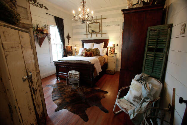 Master bedroom in the home of Shane and Jayme Boscamp. Photo: Helen L. Montoya, San Antonio Express-News / ©2013 San Antonio Express-News