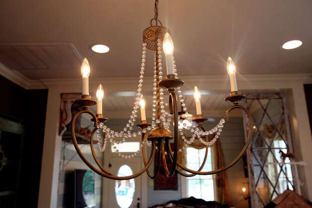Chandelier in the kitchen at the home of Shane and Jayme Boscamp. Photo: Helen L. Montoya, San Antonio Express-News / ©2013 San Antonio Express-News