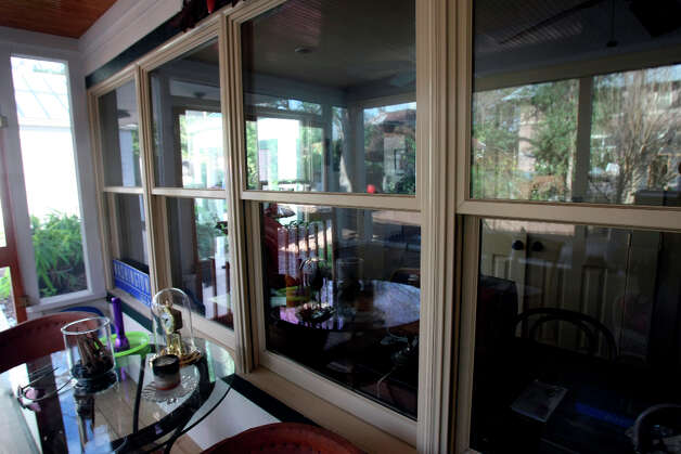 Double paned windows in Janie Barrera's home.  Barrera has made green improvements to her nearly 100-year-old King William home without sacrificing the history of the house. Barrera has rigged rain catchers to plant her garden and has tankless hot water heaters in her home. Photo: Helen L. Montoya, San Antonio Express-News / ©2013 San Antonio Express-News