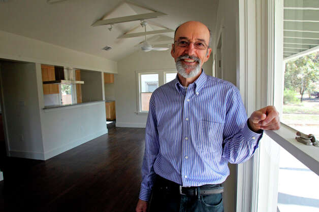 John Hertz shows his restored house near Brackenridge Park  on February 7, 2013.  The house was completely overhauled with insulation installed in all exterior surfaces. Photo: Tom Reel, San Antonio Express-News / ©2012 San Antono Express-News
