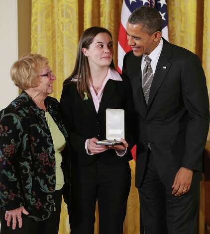 "President Barack Obama presents Erica and Cheryl Lafferty with the 2012 Presidential Citizens Medal, the nation's second-highest civilian honor, on behalf of their mother and daughter Dawn Lafferty Hochsprung in the East Room of the White House February 15, 2013 in Washington, DC. Principal Dawn Lafferty Hochsprung was killed during a mass shooting that left 26 people dead at Sandy Hook Elementary School in December 2012. ""Their selflessness and courage inspire us all to look for opportunities to better serve our communities and our country,"" Obama said about this year's recepients. Photo: Chip Somodevilla, Photo By Chip Somodevilla/Getty / 2013 Getty Images"