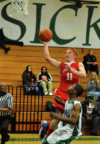 Greenwich's #11 Alex McMurray goes up to the basket, during boys basketball action against Bassick in Bridgeport, Conn. on Friday February 15, 2013. Photo: Christian Abraham / Connecticut Post