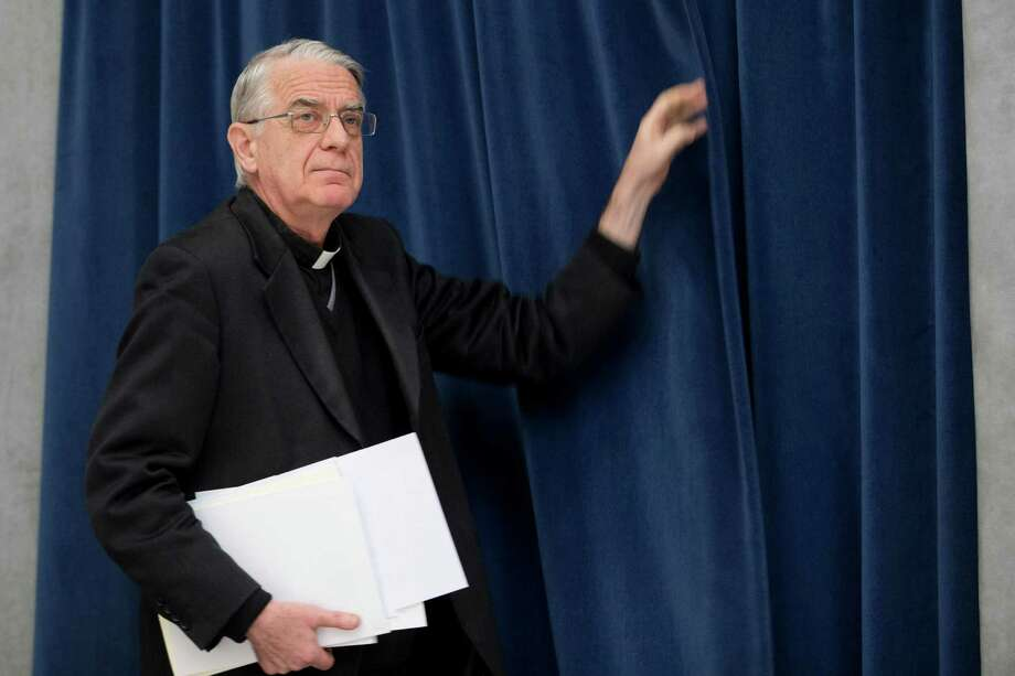 "Vatican spokesman Rev. Federico Lombardi arrives to meet the media during a press conference, at the Vatican, Friday Feb. 15, 2013. Pope Benedict XVI has signed off on one of the last major appointments of his papacy, approving a German lawyer to head the Vatican's embattled bank. Ernst Von Freyberg has solid financial and Catholic credentials as a member of the Sovereign Military Order of Malta, an ancient chivalrous order drawn from European nobility. The Vatican said Von Freyberg had been appointed by the bank's commission of cardinals and that the pope had ""expressed his full consent."" (AP Photo/Andrew Medichini) Photo: Andrew Medichini / AP"