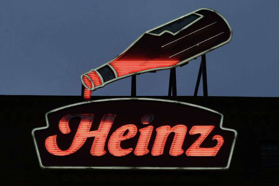 Berkshire Hathaway and 3G on Thursday announced they planned to buy Heinz for $23.3 billion. Heinz's stock rose nearly 20 percent after the announcement. Photo: Gene J. Puskar / Associated Press