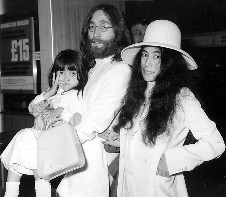 Beatles singer, songwriter and guitarist John Lennon with his wife Yoko Ono at London's Heathrow airport before flying to the Bahamas to stage a seven day 'Bed In For Peace' protest. With them is Kyoko, Yoko's daughter by her previous marriage, who Lennon is carrying.   (Photo by Central Press/Getty Images) Photo: Central Press