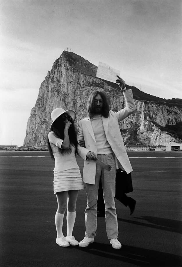John Lennon and Yoko Ono, both dressed in white, with their marriage certificate after their wedding in Gibraltar, March 20, 1969. (Photo by Simpson/Express/Getty Images) Photo: Simpson
