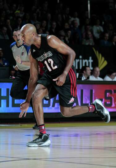 Former NBA great Bruce Bowen celebrates a made three pointer during the 2013 Sprint All-Star Celebri