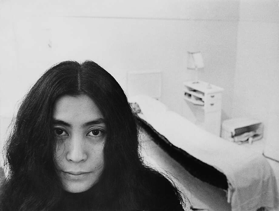 Japanese artist and musician Yoko Ono sits in a white-painted half bedroom entitled 'Half-a-Room', part of her avant-garde Half-a-Memory exhibition, on show at the Lisson Gallery in London, July 1968.  Photo: Roger Jones, Getty Images