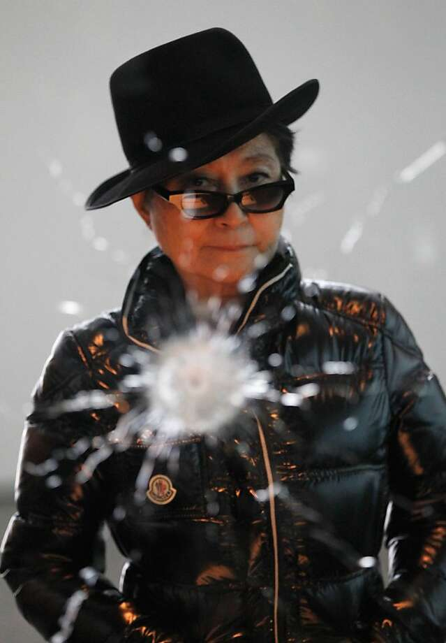 "Artist Yoko Ono stands in front of her piece ""A Hole"" ahead of the opening of her art installation ""Das Gift"" at the Haunch of Venison gallery on September 10, 2010 in Berlin, Germany.  (Photo by Sean Gallup/Getty Images) Photo: Sean Gallup, Getty Images"