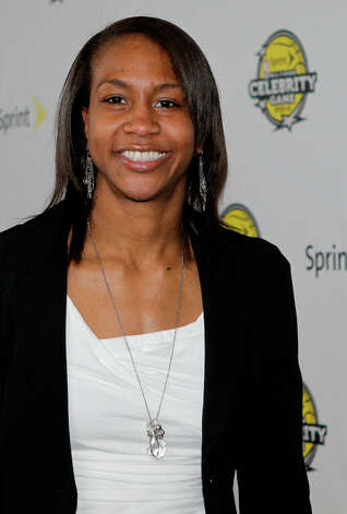 WNBA Indiana Fever player Tamika Catchings arrives on the Yellow Carpet for the All-Star Celebrity Game. Photo: Melissa Phillip, Houston Chronicle / © 2013 Houston Chronicle