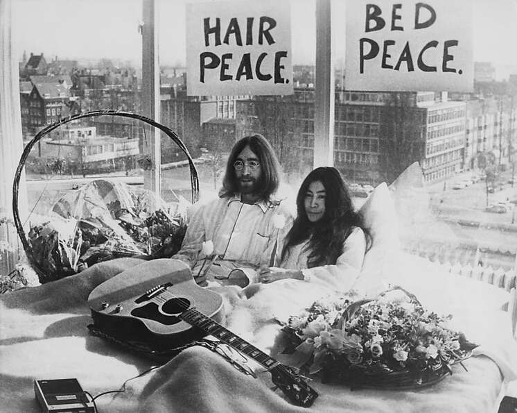 Beatle John Lennon and his wife of a week Yoko Ono in their bed in the Presidential Suite of the Hil
