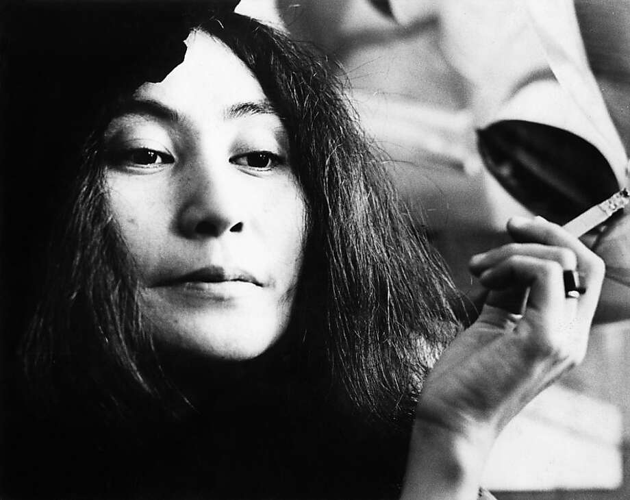 Yoko Ono posed with a cigarette in Selfridges department store, Oxford Street, London in 1971 to promote the publication of the 2nd edition of her book Grapefruit. Yoko Ono — artist, musician and wife of the late Beatle John Lennon — turns 80 on Feb. 18.  Photo: Gijsbert Hanekroot