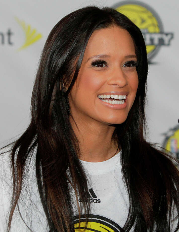 Rocsi Diaz with Entertainment Tonight arrives on the Yellow Carpet for the All-Star Celebrity Game. Photo: Melissa Phillip, Houston Chronicle / © 2013 Houston Chronicle