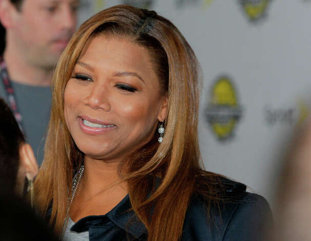 Queen Latifah arrives on the Yellow Carpet for the All-Star Celebrity Game. Photo: Melissa Phillip, Houston Chronicle / © 2013 Houston Chronicle