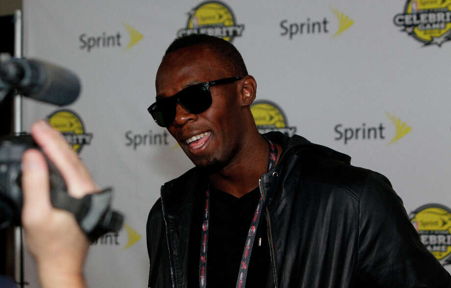 Olympic gold medal sprinter Usain Bolt arrives on the Yellow Carpet for the All-Star Celebrity Game. Photo: Melissa Phillip, Houston Chronicle / © 2013 Houston Chronicle