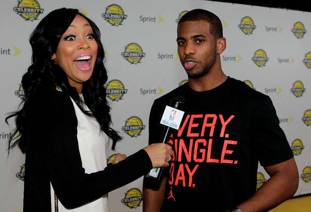 Singer Monica interviews Chris Ball on the Yellow Carpet for the All-Star Celebrity Game. Photo: Melissa Phillip, Houston Chronicle / © 2013 Houston Chronicle