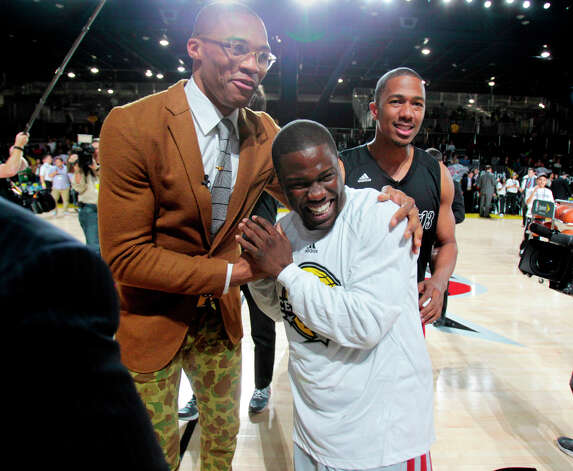 (l-r) Oklahoma City Thunder guard Russell Westbrook shares a laugh with comedian Kevin Hart ,and actor Nick Cannon during the 2013 Sprint All-Star Celebrity game. Photo: Billy Smith II, Houston Chronicle / © 2013 Houston Chronicle