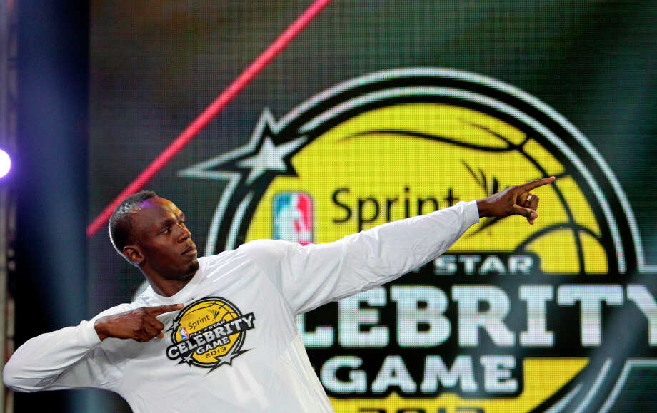 Olympic Gold Medal Sprinter Usain Bolt during the introuctions at the  2013 Sprint All-Star Celebrity game. Photo: Billy Smith II, Houston Chronicle / © 2013 Houston Chronicle