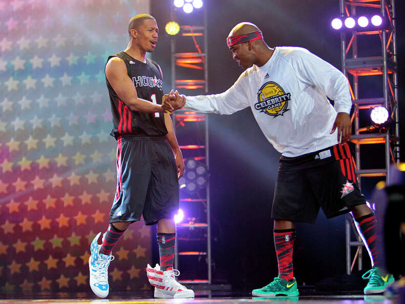 (l-r) Actor Nick Cannon greets singer Ne-Yo during the 2013 Sprint All-Star Celebrity game.