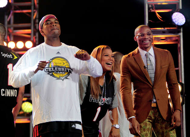 Singer Ne-Yo, and rapper Queen Latifah, along with Oklahoma City guard Russell Westbrook during intros of  the 2013 Sprint All-Star Celebrity game. Photo: Billy Smith II, Houston Chronicle / © 2013 Houston Chronicle