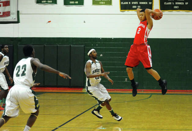 Greenwich's #2 C.J. Byrd passes the ball, during boys basketball action against Bassick in Bridgeport, Conn. on Friday February 15, 2013. Photo: Christian Abraham / Connecticut Post