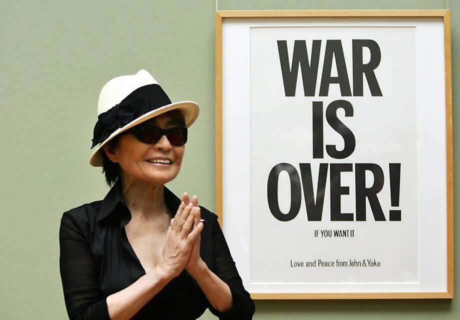 "Japanese-born artist Yoko Ono, widow of John Lennon, poses 12 June 2007 in Bremen in front of one of her works, during the presentation of her exhibition ""Window for Germany"" at the Kunsthalle.  Photo: David Hecker, AFP/Getty Images"