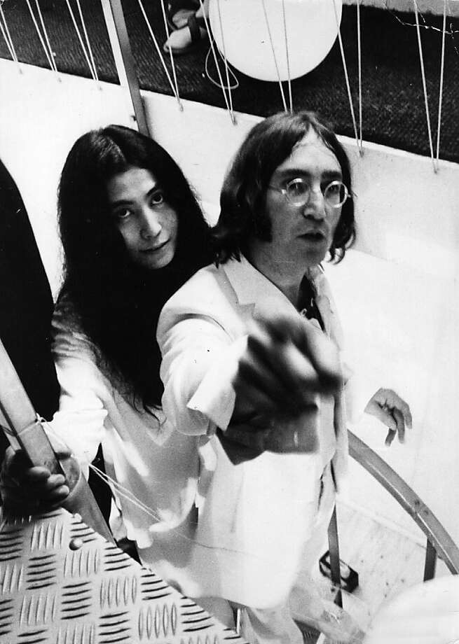 July 1968:  Beatles singer, songwriter and guitarist John Lennon and his partner, artist Yoko Ono descend a staircase.  (Photo by Evening Standard/Getty Images) Photo: Evening Standard