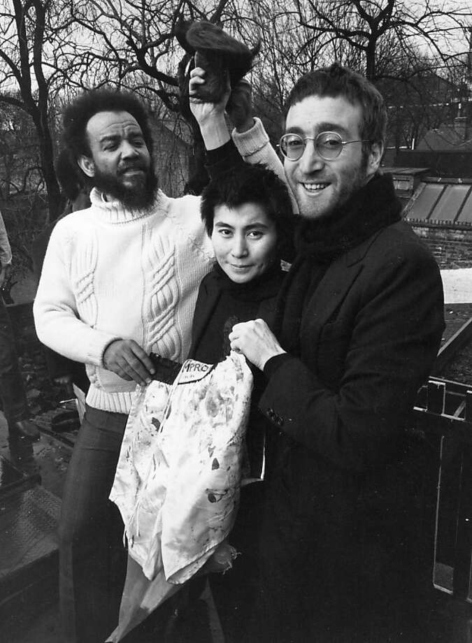 1970: John Lennon and Yoko Ono give their newly cut hair to black power leader Michael X, in return for a pair of Muhammad Ali's bloodied boxing shorts.  Photo: Terry Disney