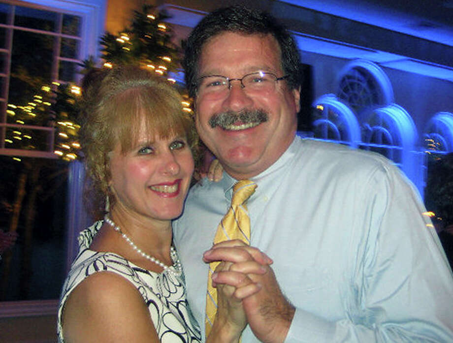 This undated photo provided by Mark Sherlach shows him with his wife, school psychologist Mary Sherlach, who was killed Friday, Dec. 14, 2012, when a gunman opened fire at Sandy Hook Elementary School, in Newtown, Conn.  Mary Sherlach will be one of six educators from the school honored posthumously with the 2012 Presidential Citizens Medal, presented at a White House ceremony on Feb. 15, 2013. Photo: Associated Press / Mark Sherlach