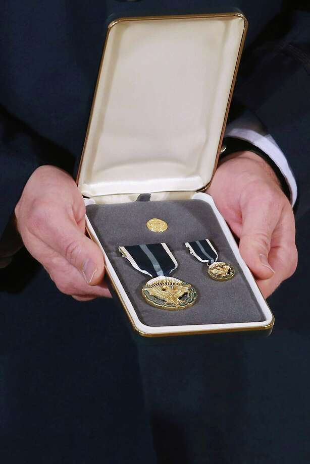 A 2012 Presidential Citizens Medal, the nation's second-highest civilian honor, that U.S. President Barack Obama will present to recepients is held in the East Room of the White House February 15, 2013 in Washington, DC. Photo: Chip Somodevilla, Getty Images / 2013 Getty Images