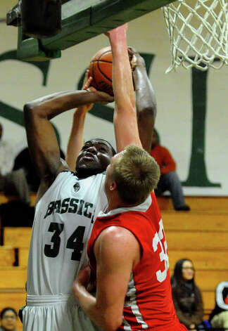Greenwich's #32 Alex Wolf tries to block a shot attempt by Bassick's #22 Dale Kirkland, during boys basketball action in Bridgeport, Conn. on Friday February 15, 2013. Photo: Christian Abraham / Connecticut Post