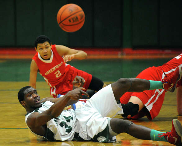 Bassick's #34 Dale Kirkland passes the ball, during boys basketball action against Greenwich in Bridgeport, Conn. on Friday February 15, 2013. Photo: Christian Abraham / Connecticut Post