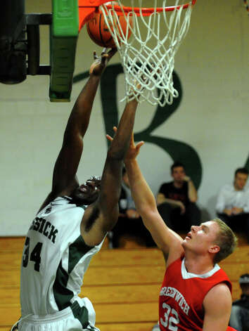Bassick's #34 Dale Kirkland attempts a shot, during boys basketball action against Greenwich in Bridgeport, Conn. on Friday February 15, 2013. Photo: Christian Abraham / Connecticut Post